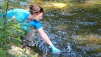Kristy Deiner samples the water
